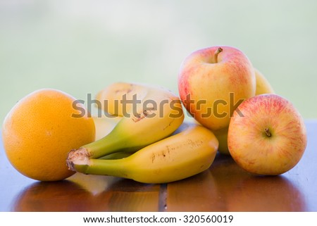 variety of fruits on table in the garden