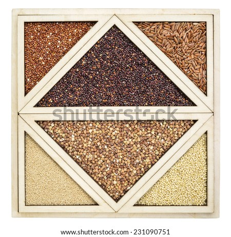 variety of gluten free grains (red and black quinoa, buckwheat, brown rive, amaranth and millet) in a wooden tray - stock photo