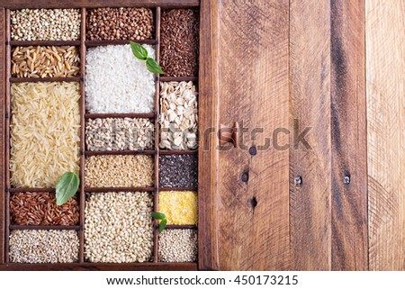 Variety of healthy grains and seeds in a wooden box mostly gluten free with rice, quinoa and buckwheat - stock photo