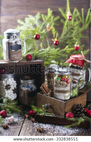 Variety of homemade edible gifts including cookie mix, hot chocolate mix and brownie mix - stock photo
