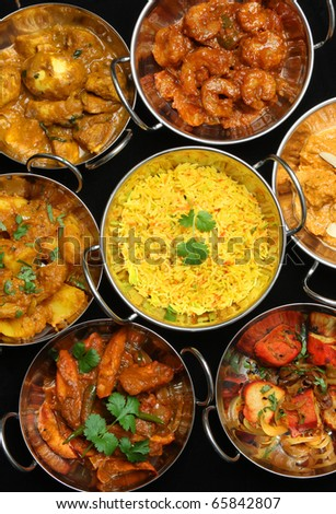 Variety of Indian curries and rice. - stock photo