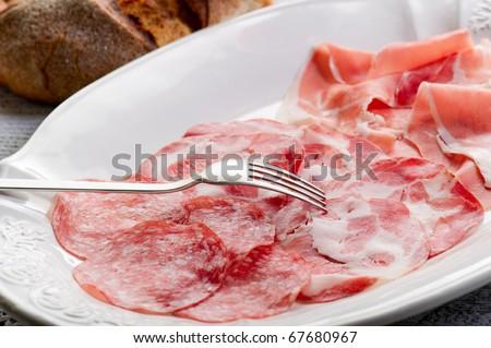 variety of italian salami and parma ham - stock photo