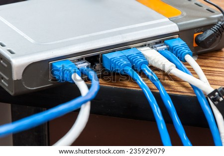 Variety of lan cable behind the modern router - stock photo