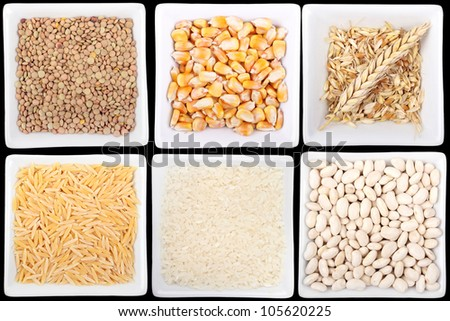 variety of legumes and cereals in bowls - stock photo