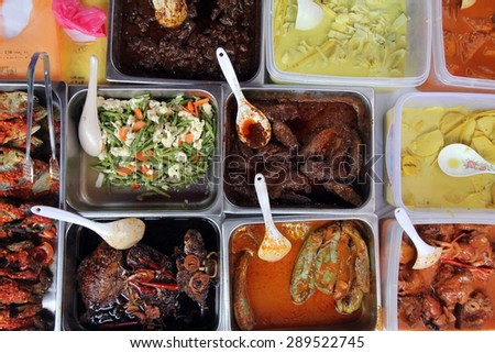 Variety of Malay food dishes at a stall at a ramadhan bazaar in Kuala Lumpur, Malaysia  - stock photo