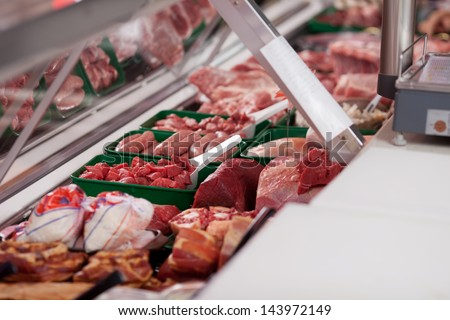 Variety of meat displayed in butcher's shop - stock photo