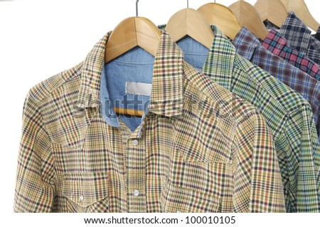 Variety of Men's different colors short sleeved plaid cotton on a hanger - stock photo