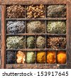 Variety of natural Indian spices in a wooden box, shot from a high angle - stock