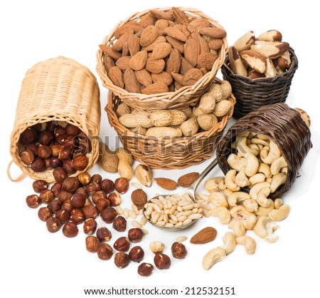 variety of nuts in wicker baskets  isolated on white background - stock photo