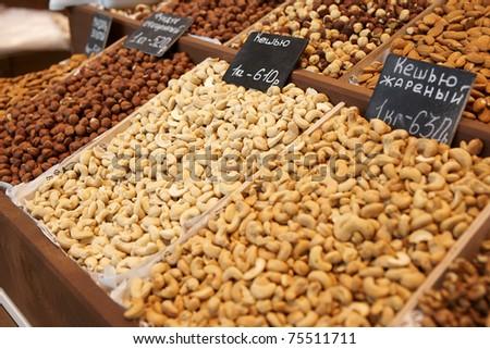 Variety of nuts on street market - stock photo