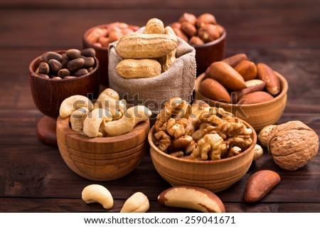 Variety of nuts: walnut, hazelnut, cashew, peanuts,  pine nuts and other - stock photo
