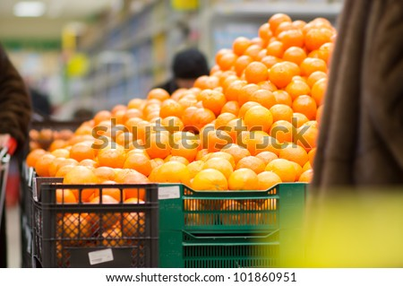 Variety of oranges on boxes in supermarket