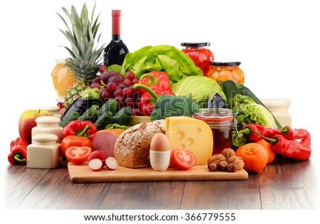 Variety of organic food including vegetables fruit bread dairy and meat. Balanced diet. - stock photo