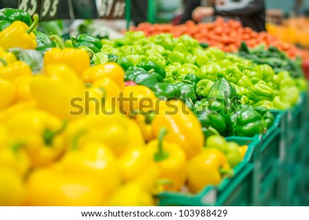 Variety of peppers in boxes in supermarket - stock photo