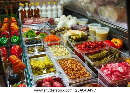 Variety of pickled vegetables and mushrooms in a store - stock photo