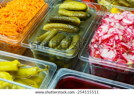 Variety of pickled vegetables in a store - stock photo