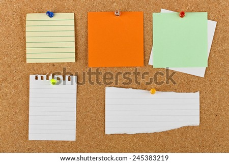 variety of pinned blank notes on cork notice board - stock photo