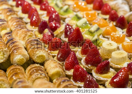 variety of puff pastry cream and fruits pastries