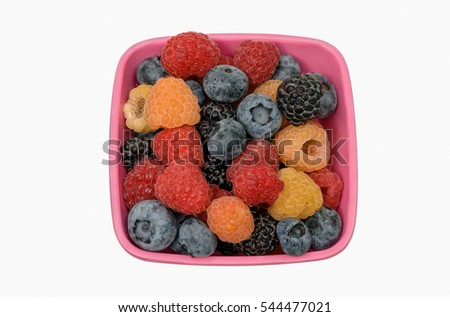 Variety of Raspberries and Blueberries in Dish on White