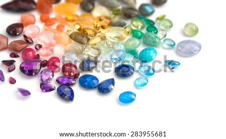 Variety of real colorful precious gems: blue topaz, emerald, ruby, moonstones, labradorites, amethyst, rose quartz, tiger eye, peridot,aquamarine, sapphire, citrine, lapis lazuli, fluorite and more - stock photo
