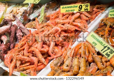 Variety of sea food on market's counter - stock photo
