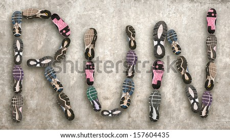 Variety of shoes./ Different shoe sole forming the word run.  - stock photo