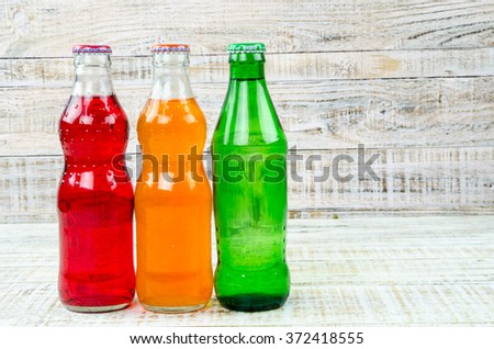 variety of soda bottle on the wooden background