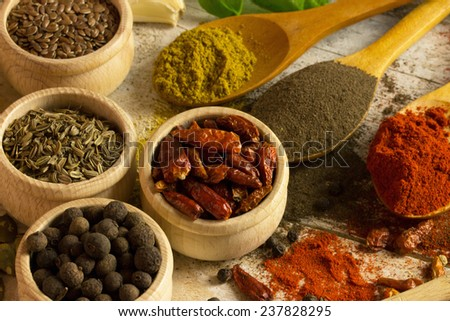 variety of spices on a wooden cutting board - stock photo