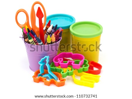 Variety of stationery ( molding dough, cutters, crayons, scissors) for children isolated on white background - stock photo