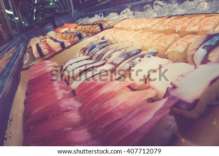 Variety of Sushi. Vintage filter tone. - stock photo