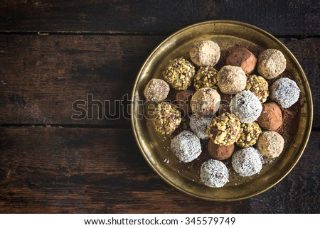 Variety of sweet homemade chocolate pralines in the plate,selective focus and blank space  - stock photo