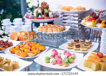 Variety of sweets on table - stock photo