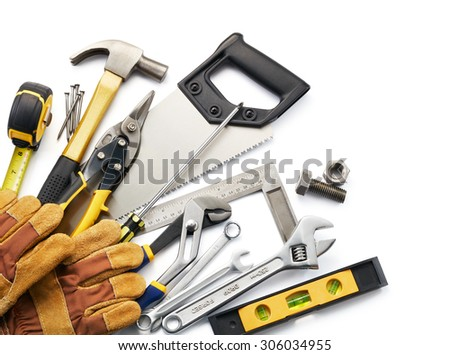variety of tools against white background with copy space - stock photo