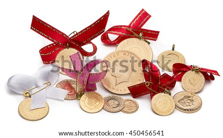Variety of traditional Turkish gold coins isolated on white background. - stock photo