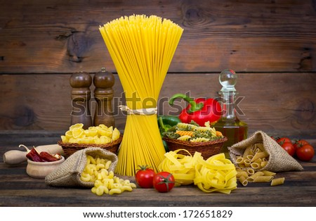 Variety of uncooked pasta and vegetables - stock photo