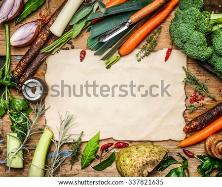 variety of vegetables ingredients for soup or broth cooking around blank sheet of paper on rustic wooden background, top view. Healthy clean food or diet concept. - stock photo