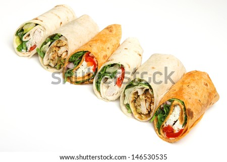 Variety of wrap sandwiches arranged in a line. - stock photo