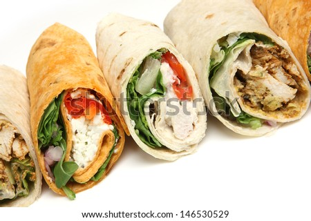 Variety of wrap sandwiches with chicken and feta cheese. - stock photo