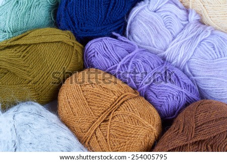 Variety of yarn skeins photographed from above                              - stock photo