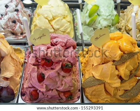 Variety of yummy ice creams under shopping window  - stock photo