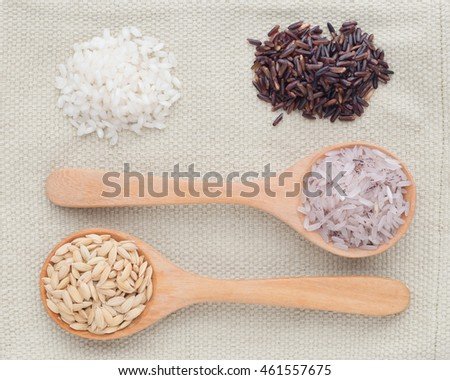 Variety rice in the bowl on sackcloth background with healthy concept
