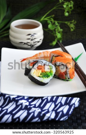 variety sushi japanese food on white plate