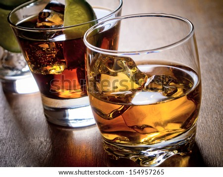 Various alcoholic cocktails on a wooden table - stock photo
