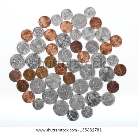 Various American coins (quarters, dimes, nickels, pennies) displayed on white background. DEAR INSPECTOR: This is NOT an 'isolated on white image'. - stock photo