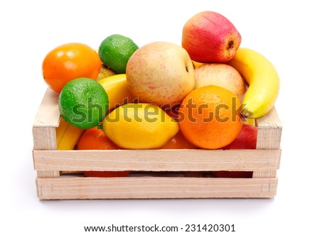 Various artificial plastic fruits in wooden crate - concept of bad quality products on the market - stock photo