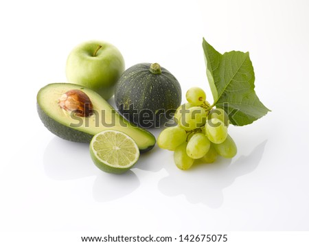 Various, assorted fruits and vegetables(grape, apple, pumpkin, avocado, lime, green apple) with leaf, isolated on the white background with soft shadow - stock photo