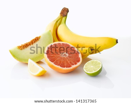 Various, assorted fruits (Banana, lime, lemon, grapefruit, melon), isolated on the white background with soft shadow - stock photo