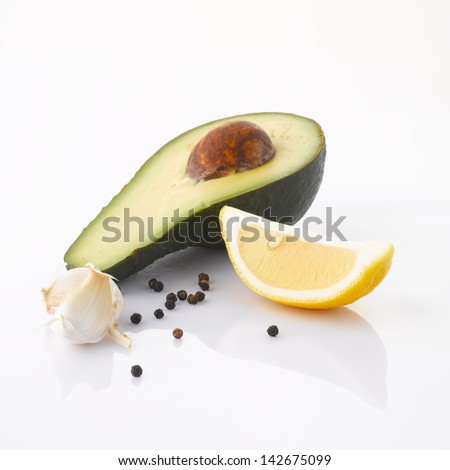 Various, assorted vegetables(avocado, garlic, lime, pepper) isolated on the white background with soft shadow. Ingredients of avocado cream. - stock photo
