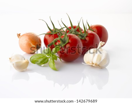 Various, assorted vegetables( tomato, garlic, onion, basil leaf) isolated on the white background with soft shadow. Ingredients of italian cuisine. - stock photo