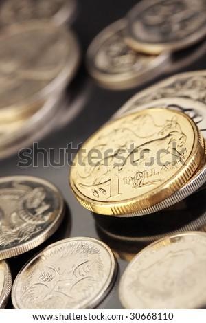 Various australian coins, focus on gold 1 dollar coin. - stock photo